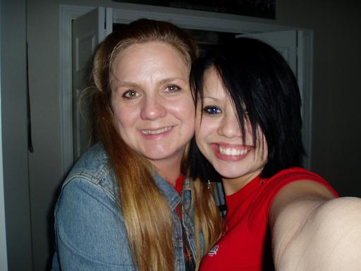My mom and myself, circa 2004. Wow, that black hair was an interesting stage.