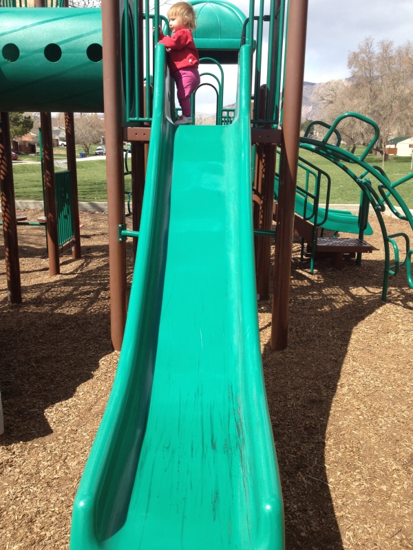 Daredevil insisted on going down the biggest slide, even after she hit her head on it.