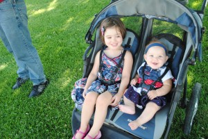 My girls in our jogging stroller last year.