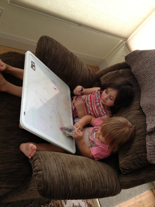 "And here's a cute picture of the girls doing some ""school work"" of their own."