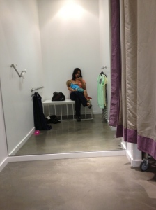 Nursing while shopping for clothes for mama.